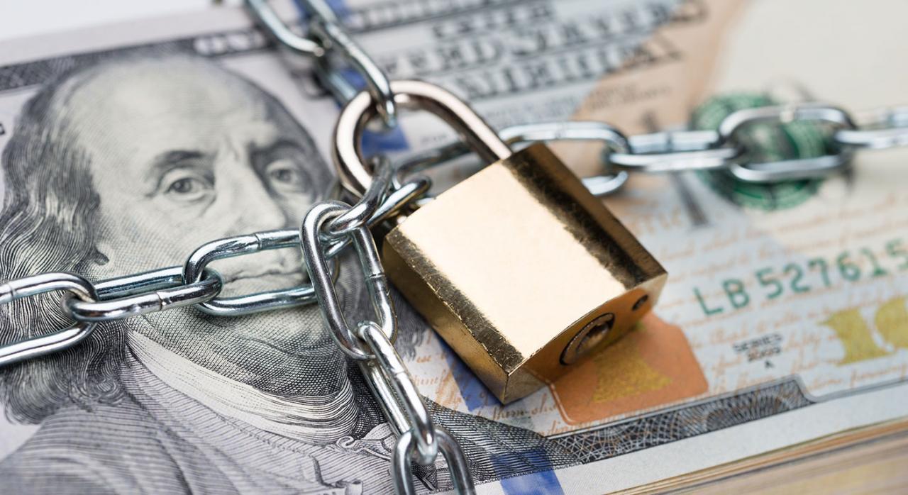 Inversiones. Imagen de una dólar y una candado