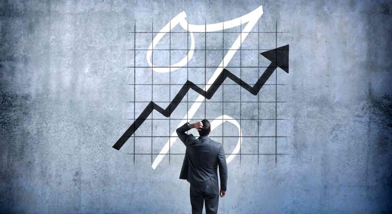 Reforma de IBOR. Empresario mirando un gráfico pintado en la pared